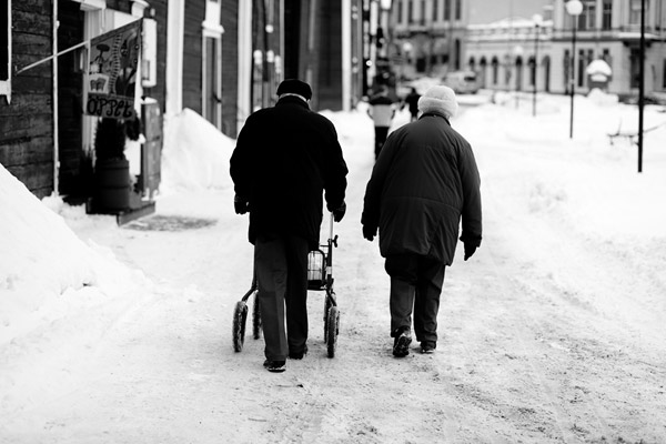 A couple walking in Hudiksvall. For how long have they walked side by side?